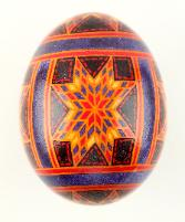 quilt inspired red and purple star chicken pysanka