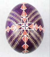 purple and red chicken egg pysanka